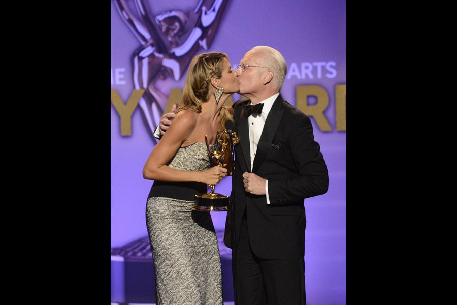 Heidi Klum and Tim Gunn accept the award for Outstanding Host for a Reality or Reality-Competition Program for Project Runway