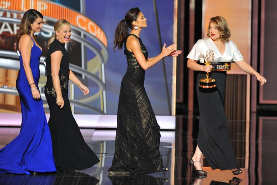 Tina Fey, Amy Poehler, and Merritt Wever on stage at the 65th Emmys