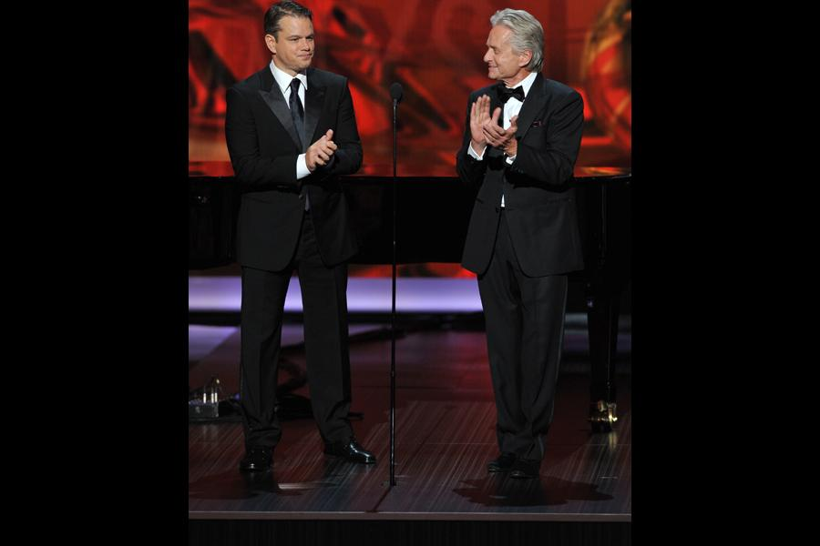 Matt Damon and Michael Douglas on stage at the 65th Emmys