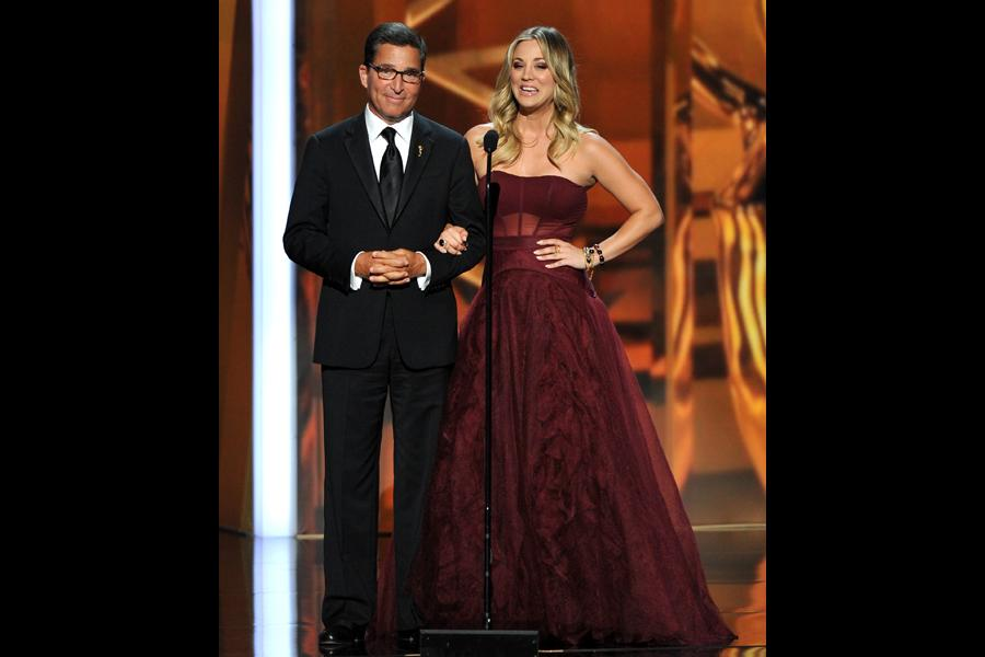 Academy Chairman and CEO Bruce Rosenblum and Kaley Cuoco introduce an In Memoriam at the 65th Emmys