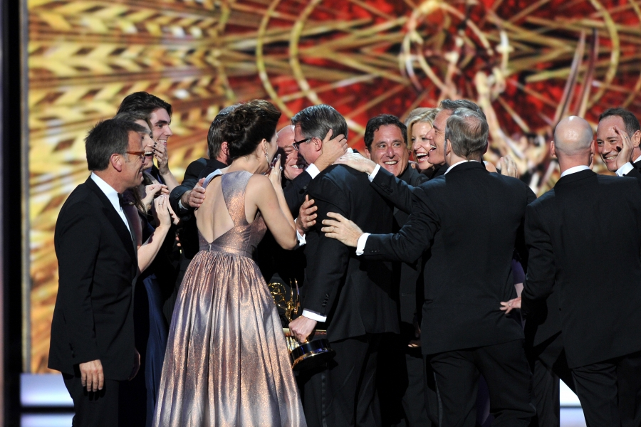 """The cast and crew of """"Breaking Bad"""" on stage at the 65th Emmys"""