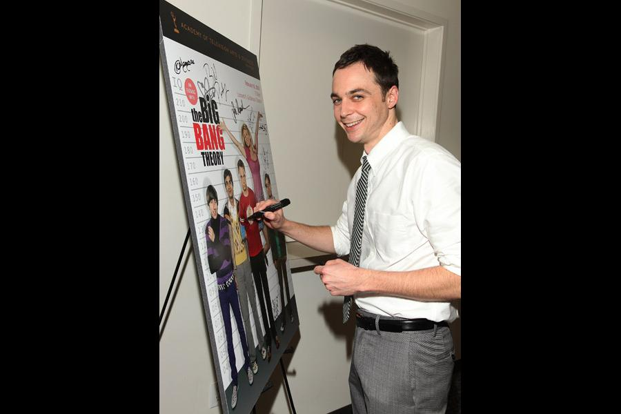 """Jim Parsons autographs the evening's poster at """"An Evening with The Big Bang Theory"""""""
