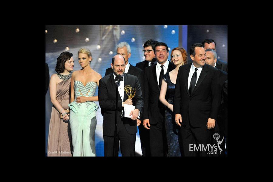 """Writer Matthew Weiner (C) and """"Mad Men"""" cast and crew"""