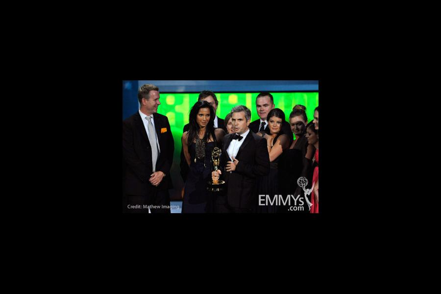 TV personality Padma Lakshmi and producer Dan Cutforth (C) and the cast and crew of Top Chef accept an award onstage at the 62nd