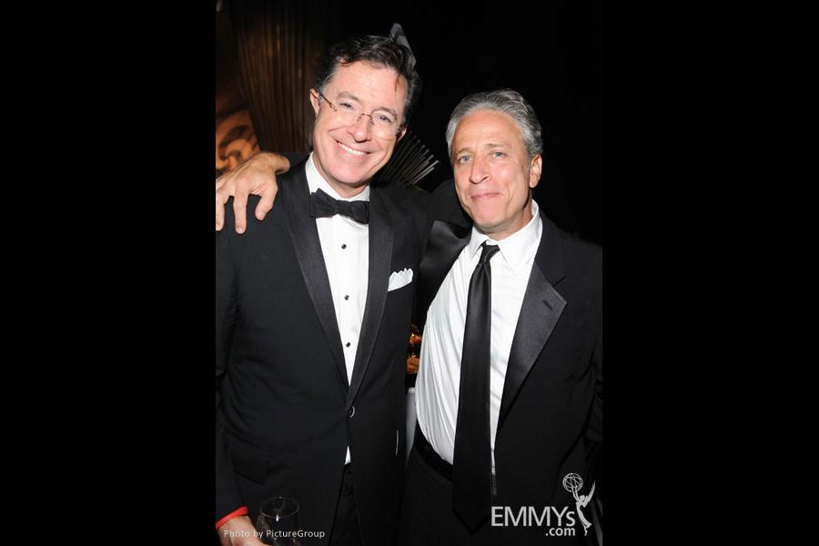 Stephen Colbert (L) and Jon Stewart at the Governors Ball during the Academy of Television Arts & Sciences 63rd Primetime Emmys