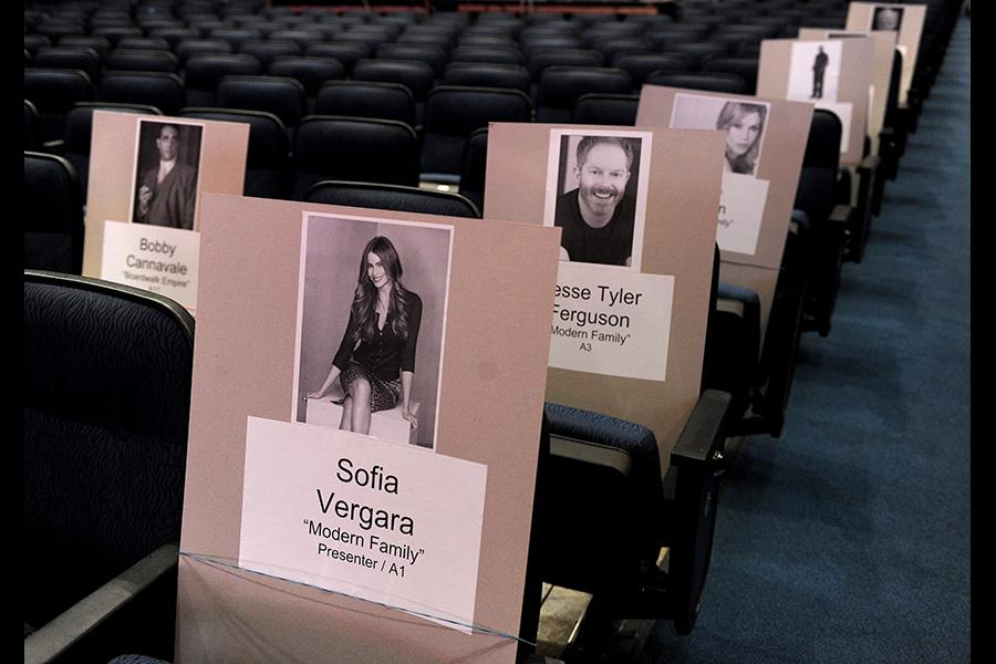 A modern family sitting together for the 65th Emmy Awards.