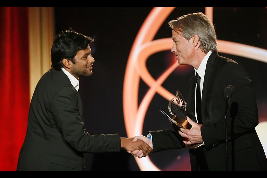"Graham Yost presents Shubhashish Bhutiani, left, of School of Visual Arts with the Directing Award for ""Kush"" at the 35th College Television Awards"