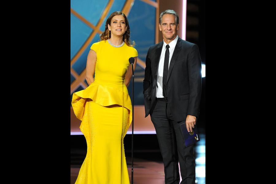 Kate Walsh (l) and Scott Bakula present an award at the 66th Emmy Awards.