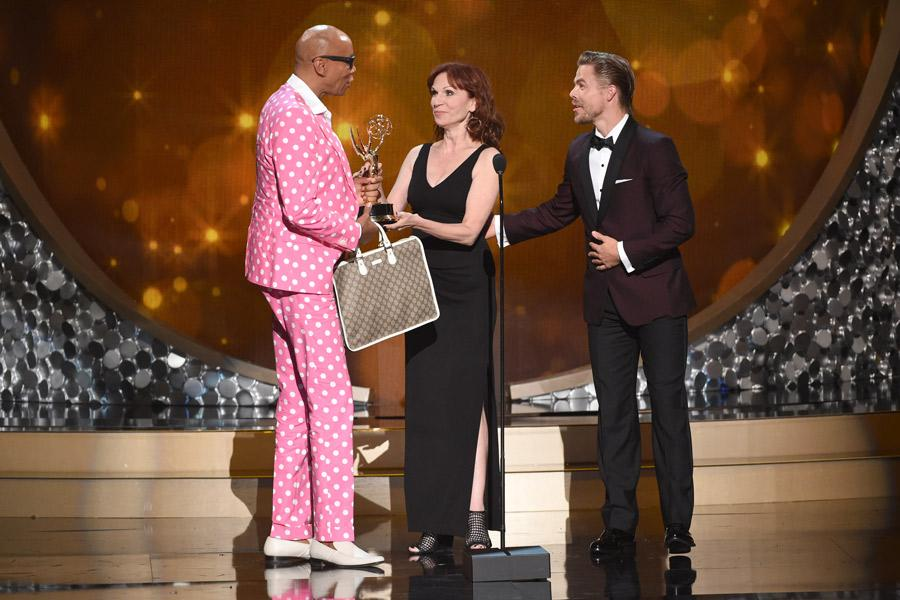RuPaul Charles accepts an award at the 2016 Creative Arts Emmys.