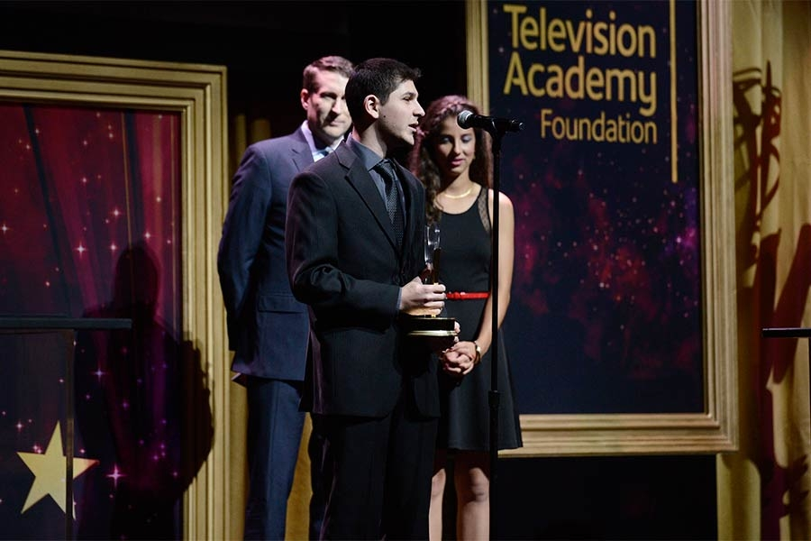 Aleksandr Rikhterman accepts an award at the 36th College Television Awards at the Skirball Cultural Center in Los Angeles, California, April 23, 2015.