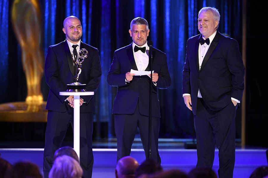 Eduardo Guisandes, Efrain Montanez and Jerry Torgerson accept an award at the 2021 Creative Arts Emmys.