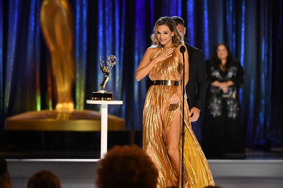 Ethan Petersen and Goloka Bolte accept an award at the 2021 Creative Arts Emmys.