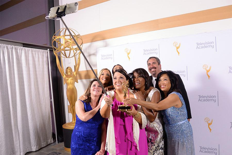 The CBS2-KCAL9 news team commemorate their evening at the 67th Los Angeles Area Emmy Awards July 25, 2015, at the Skirball Cultural Center in Los Angeles, California.