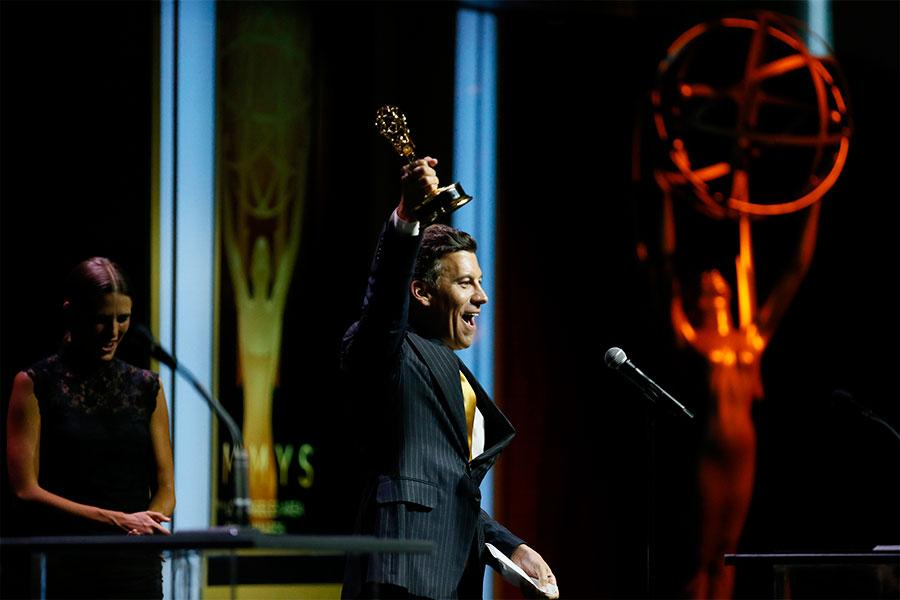 """Christopher Wolfe accepts accepts the fictional """"Best Acting Performance by a News Personality"""" award at the 67th Los Angeles Area Emmy Awards July 25, 2015, at the Skirball Cultural Center in Los Angeles, California."""