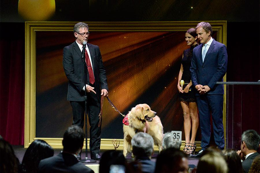 Mike Maas and Tyrion onstage at the 67th Los Angeles Area Emmy Awards July 25, 2015, at the Skirball Cultural Center in Los Angeles, California.