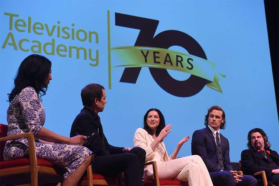 Moderator Michelle Miller, actors Tobias Menzies, Catriona Balfe, and Sam Heughan, and showrunner Ronald D. Moore on the panel at the Outlander: From Scotland to Paris event, April 5, 2016, at the NYU Skirball Center for the Performing Arts in New York Ci