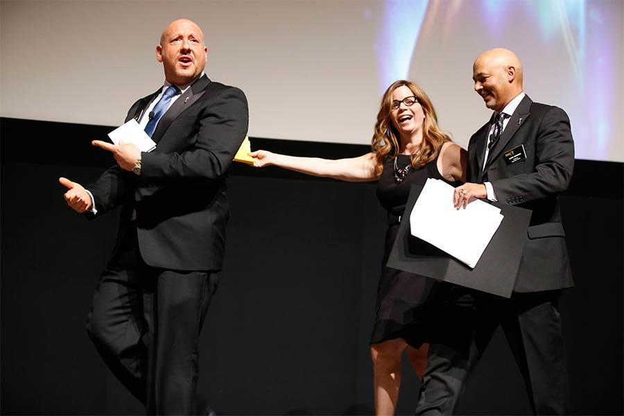 Interactive Media Peer Group Governor Seth R. Shapiro, left, and Marc Johnson, right, present the Lucy Hood Digerati Award to Lori Schwartz at the Interactive Media Peer Group Nominee Reception in North Hollywood, California.
