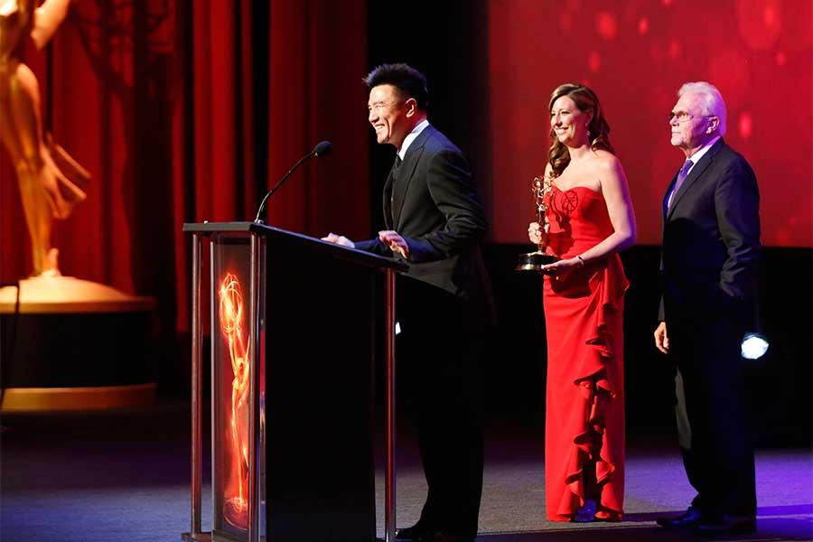 Adam Zhu accepts an award at the 68th Los Angeles Area Emmys, July 23, 2016, at the Saban Media Center, North Hollywood, California.
