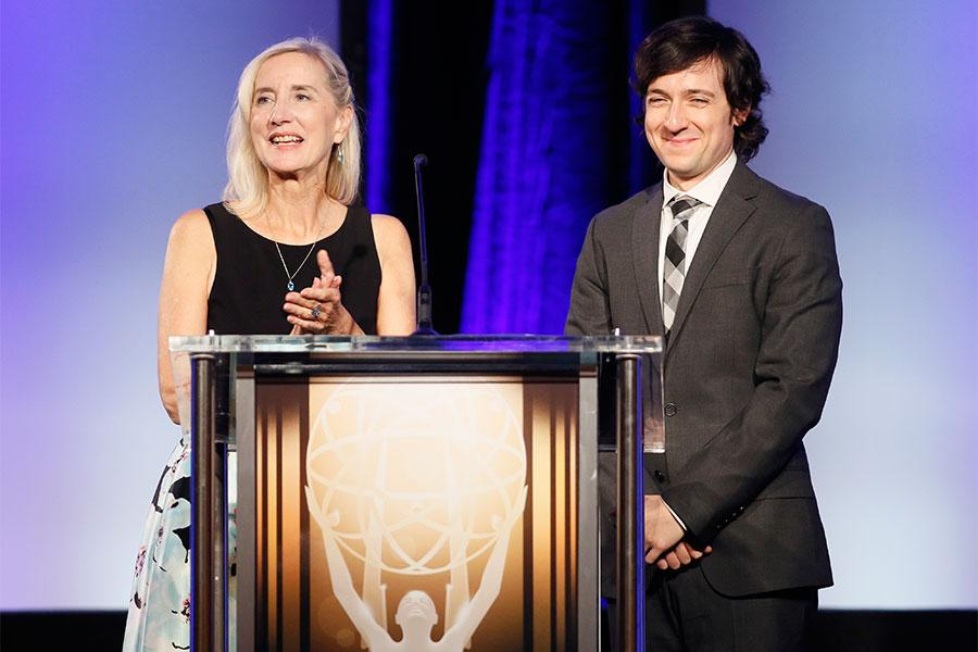 Engineering Awards committee chair Wendy Aylesworth and show host Josh Brener onstage at the 2015 Engineering Emmys at the Loews Hotel in Los Angeles, October 28, 2015.