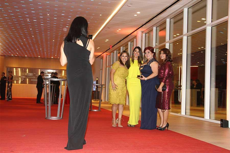 Beatriz Gomez poses with her friends and her award at the 68th Los Angeles Area Emmys, July 23, 2016, at the Saban Media Center, North Hollywood, California.