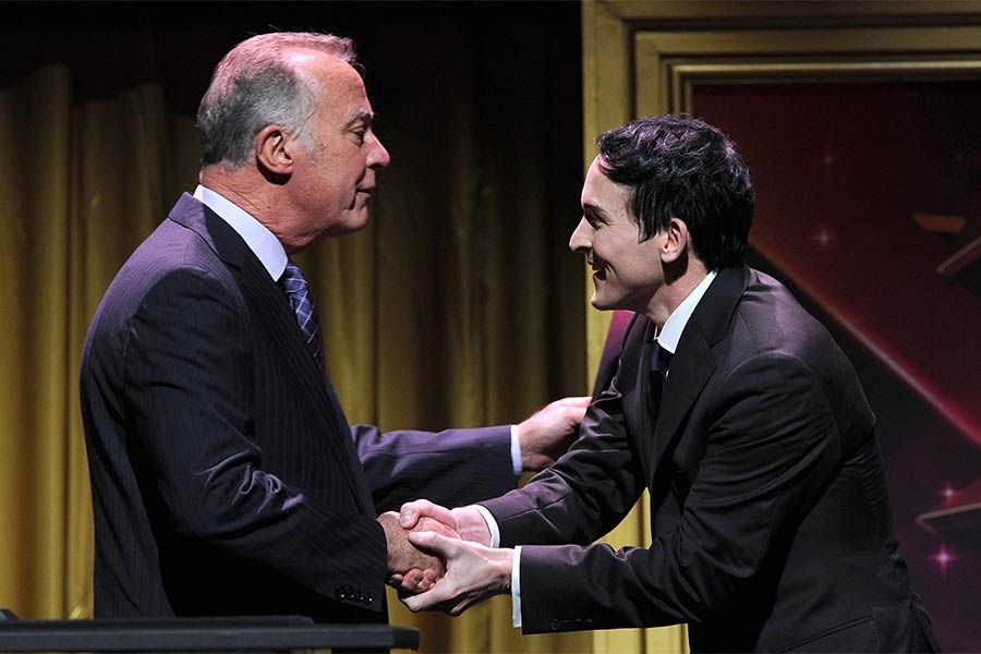 Bob Cook (L), chairman of the Television Academy Foundation, greets actor Robin Lord Taylor at the 36th College Television Awards at the Skirball Cultural Center in Los Angeles, California, April 23, 2015.