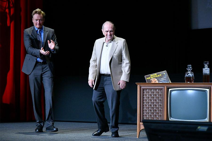 Conan O'Brien ushers Bob Newhart onstage at The Rise of the Cerebral Comedy: A Conversation with Bob Newhart, presented Tuesday, Aug. 8, 2017, at the Television Academy's Wolf Theater at the Saban Media Center in North Hollywood, California.