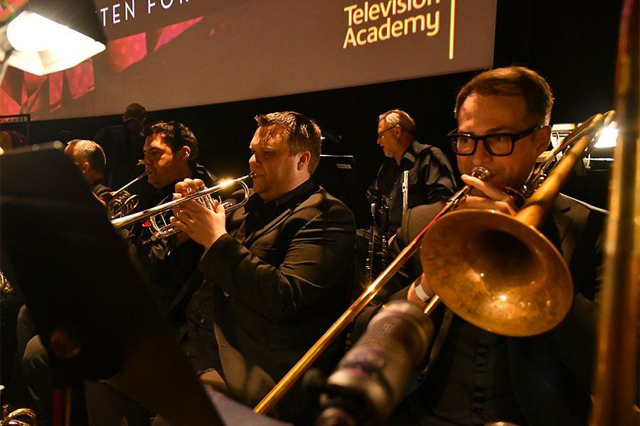 The brass section performs at WORDS + MUSIC, presented Thursday, June 29, 2017 at the Television Academy's Wolf Theatre at the Saban Media Center in North Hollywood, California.