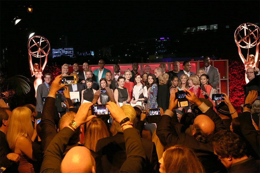 Guests grab their own photos of the nominees at the Performers Nominee Reception, September 16, 2016 at the Pacific Design Center, West Hollywood, California.