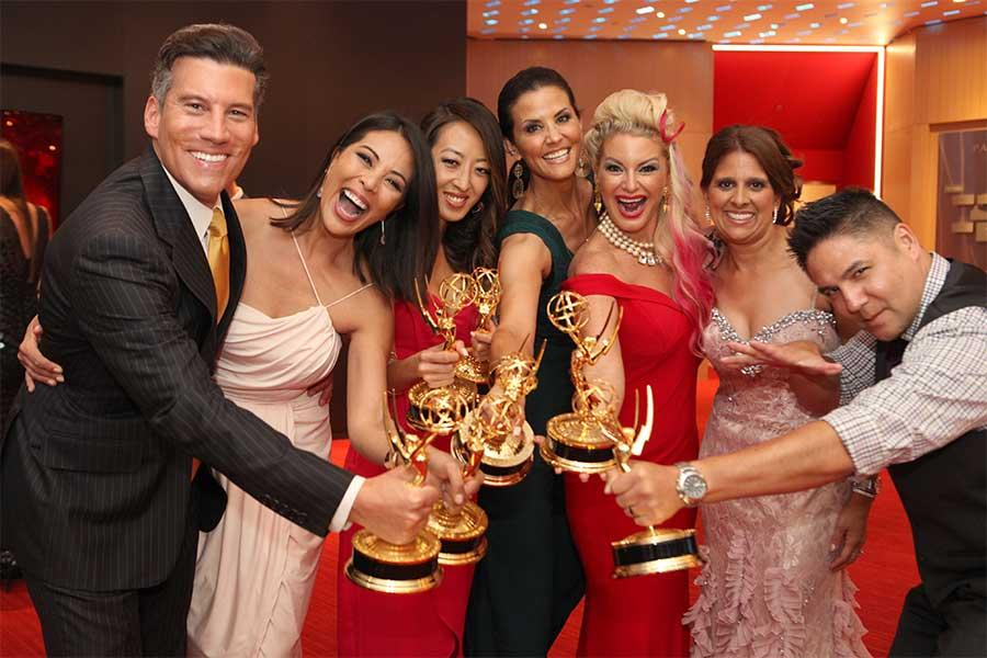 Chris Wolfe, Cher Calvin, Angel Kim, Lu Parker, Kimberly Cornell, Christie Leigh, and Phil Ige celebrate their awards at the 68th Los Angeles Area Emmys, July 23, 2016, at the Saban Media Center, North Hollywood, California.