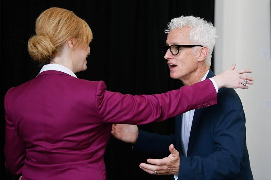 "Christina Hendricks greets John Slattery in the green room at ""A Farewell to Mad Men,"" May 17, 2015 at the Montalbán Theater in Hollywood, California."