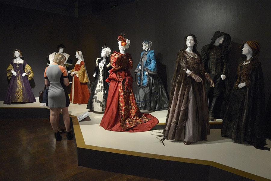 Guests enjoy the exhibits at The 9th Annual Outstanding Art of Television Costume Design Exhibition at the FIDM Museum & Galleries, Saturday, July 18, 2015, in Los Angeles.