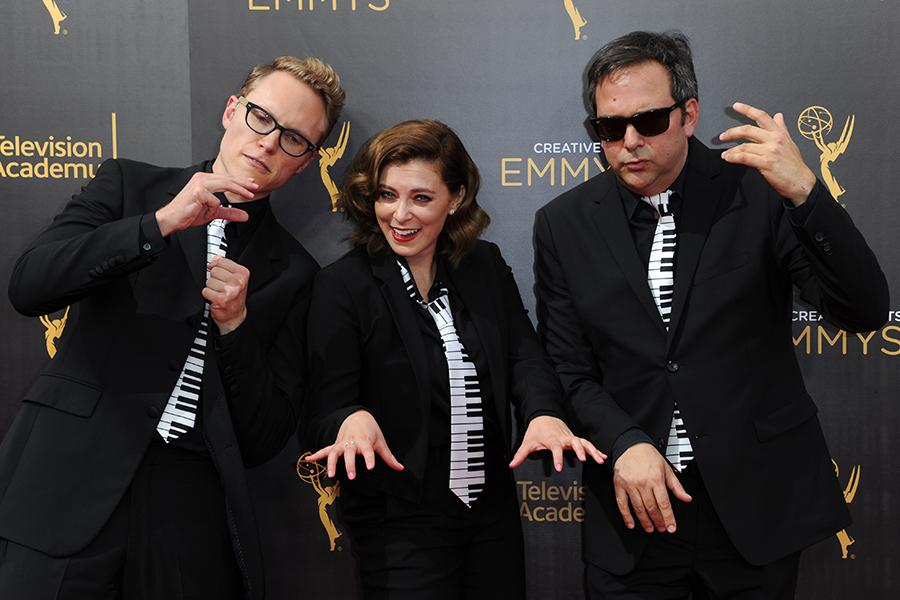 Jack Dolgen, Rachel Bloom, and Adam Schlesinger arrive on the red carpet at the 2016 Creative Arts Emmys.