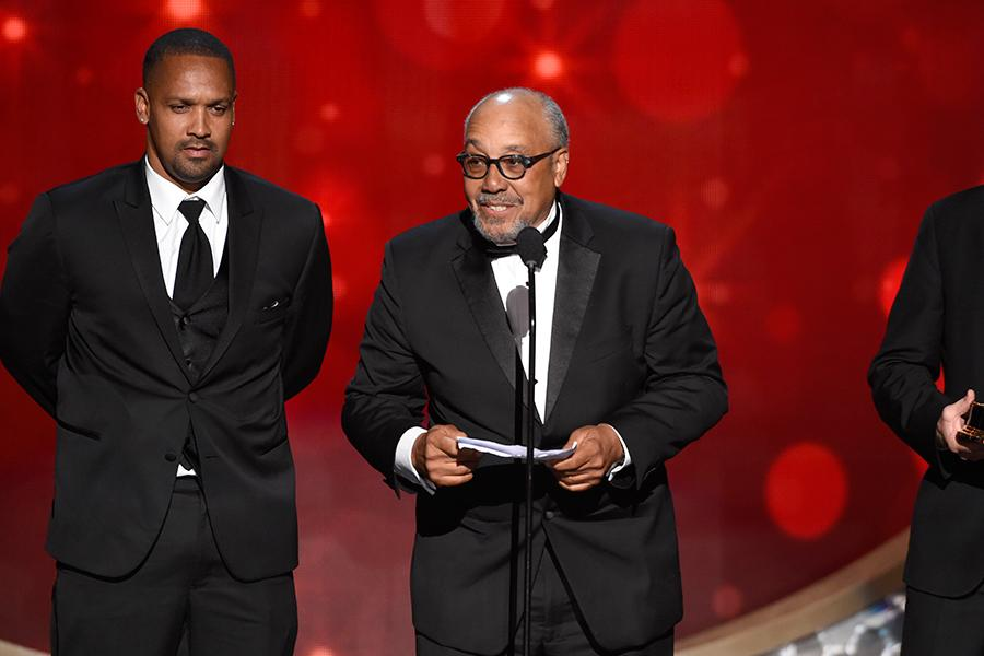 John Simmons accepts an award at the 2016 Creative Arts Emmys.