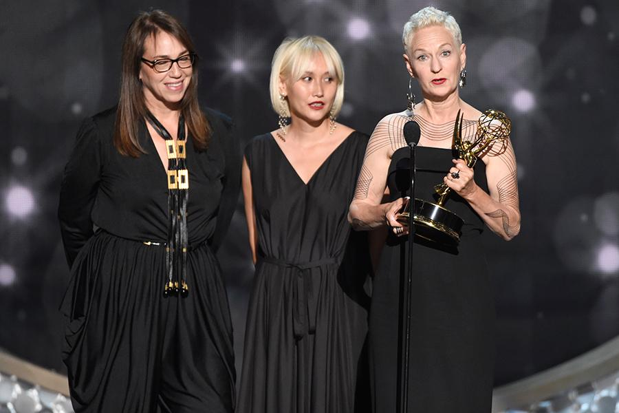 The American Horror Story: Hotel costume team accepts an award at the 2016 Creative Arts Emmys.