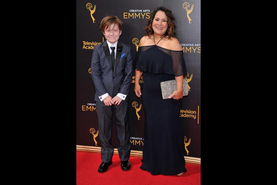 Carolyn Omine and guest on the red carpet at the 2016 Creative Arts Emmys.