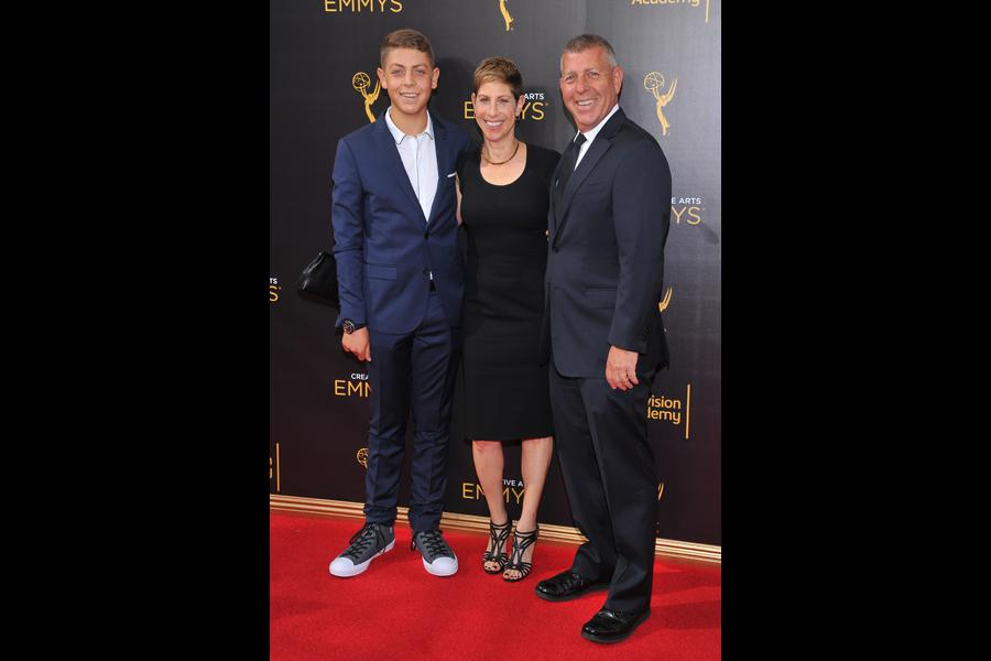 Greg Lipstone and guests on the red carpet at the 2016 Creative Arts Emmys.