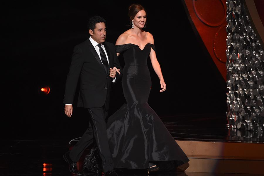 Oscar Nunez and Erinn Hayes on stage at the 2016 Creative Arts Emmys.