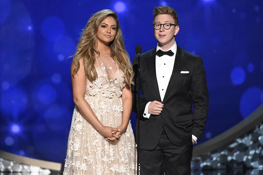 Bethany Mota and Tyler Oakley on stage at the 2016 Creative Arts Emmys.