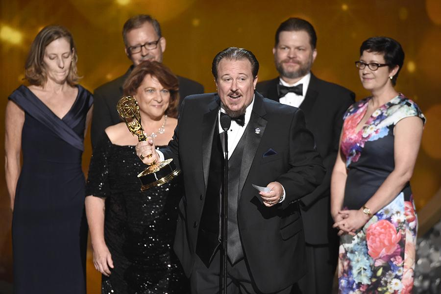 """The team from """"Who Do You Think You Are?"""" accepts the award for outstanding picture editing for a structured or competition reality program during night two of the Television Academy's 2016 Creative Arts Emmys."""