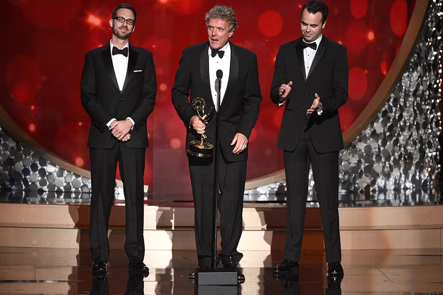 """The team from """"Grease: Live"""" accepts the award for outstanding lighting design/lighting direction for a variety series during night two of the Television Academy's 2016 Creative Arts Emmys."""