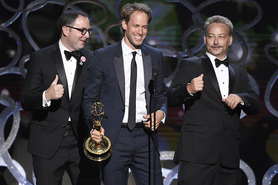 """David Korins, Joe Celli, and Jason Howard accept the award for outstanding production design for a variety, nonfiction, event or award special for """"Grease: Live"""" during night two of the Television Academy's 2016 Creative Arts Emmys."""