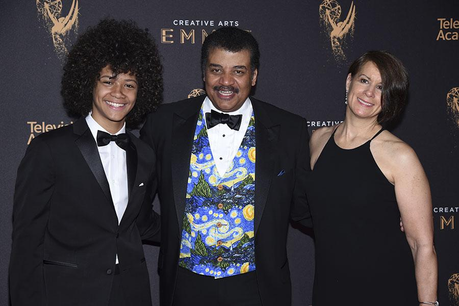 Travis Tyson, Neil deGrasse Tyson and Alice Young on the red carpet at the 2017 Creative Arts Emmys.