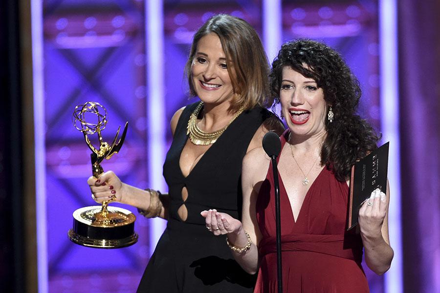 Sasha Alpert and Megan Sleep accept their award at the 2017 Creative Arts Emmys.