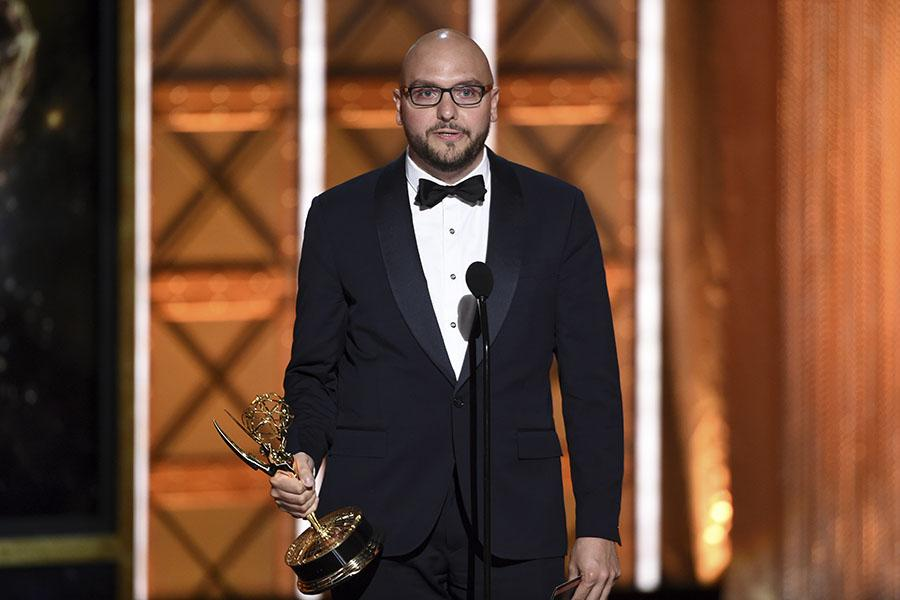 Anthony Miale accepts an award at the 2017 Creative Arts Emmys.