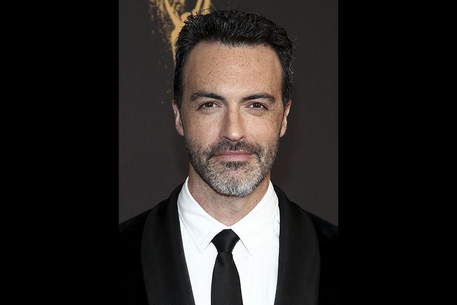Reid Scott on the red carpet at the 2017 Creative Arts Emmys.