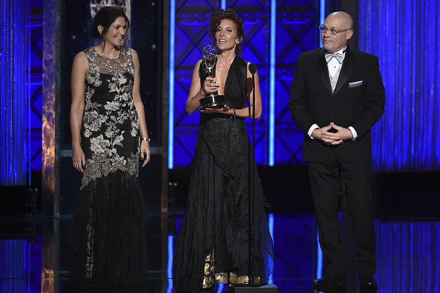 The Handmaid's Tale Production Design team accepts an award at the 2017 Creative Arts Emmys.