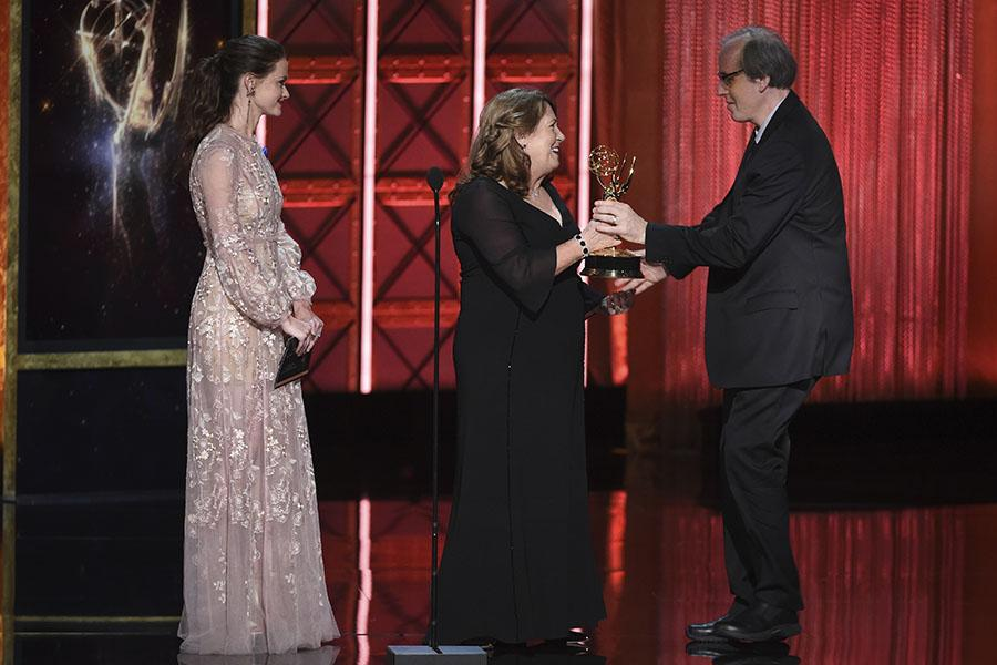 Alexis Bledel and Ann Dowd present an award to Jeff Beal at the 2017 Creative Arts Emmys.