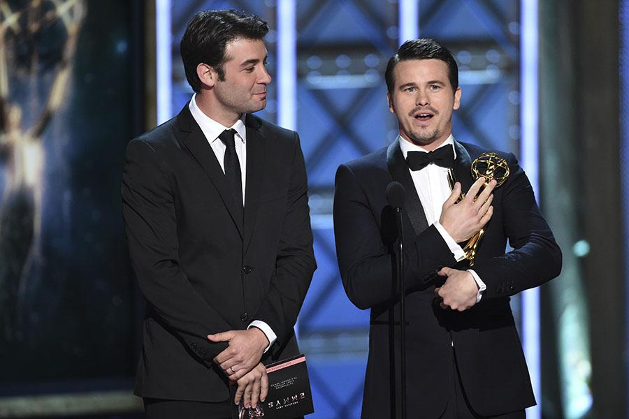 James Wolk and Jason Ritter accept an award for RuPaul Charles, who could not attend, at the 2017 Creative Arts Emmys.
