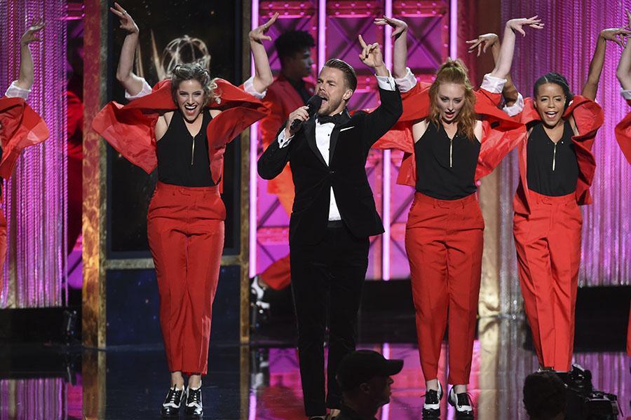 Derek Hough on stage at the 2017 Creative Arts Emmys.