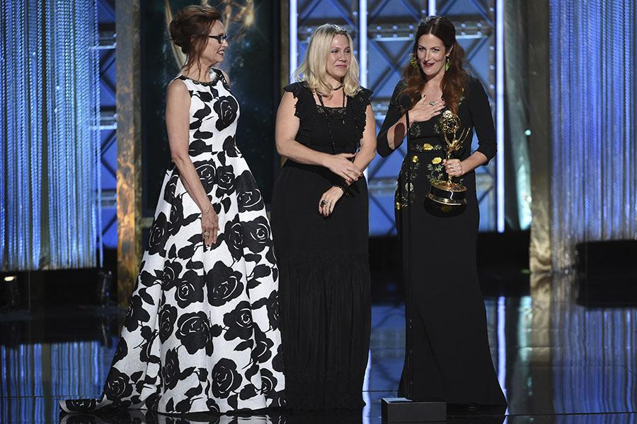 Patricia McLaughlin, from left, Risa Garcia, and Alex Friedberg accept their award at the 2017 Creative Arts Emmys.